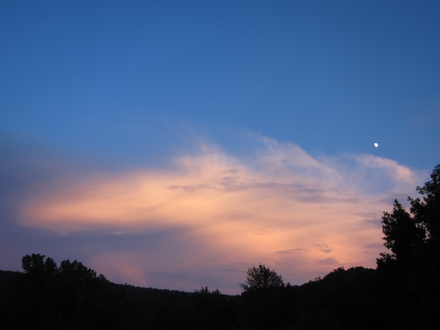 Decorative dusk moon with clouds photo